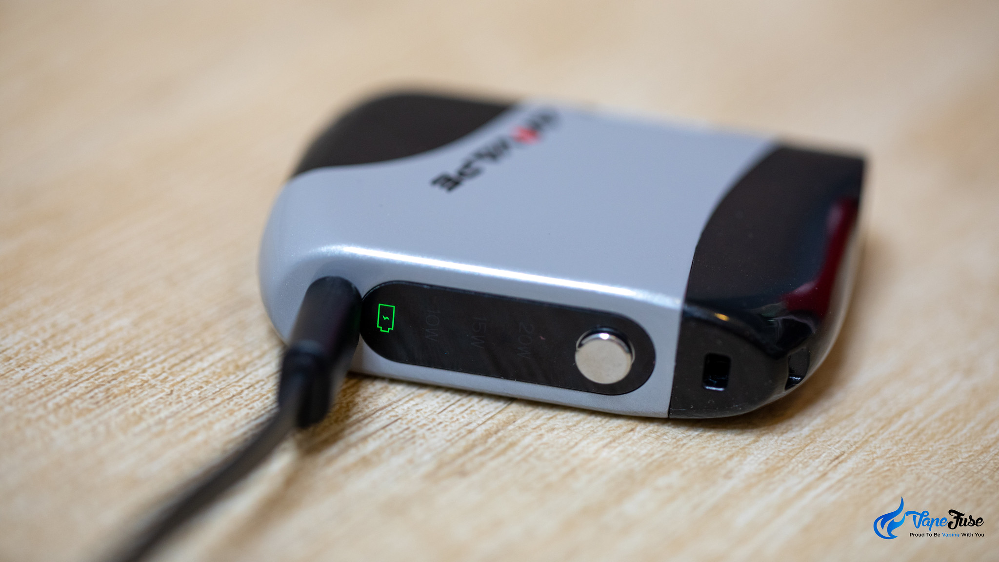 Aovape cRoll Oil Vaporizer on the charger