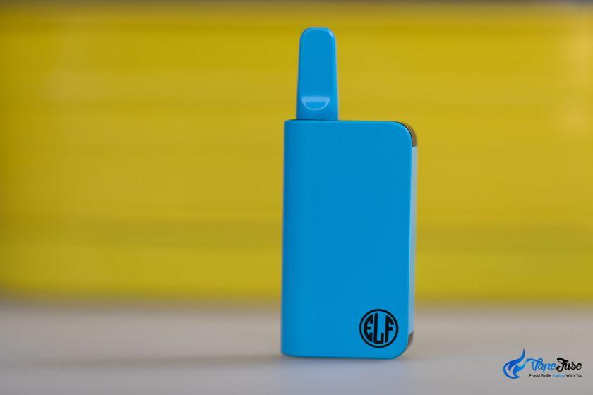 HoneyStick Elf 510 Thread Ol Cartridge Vaporizer against yellow background